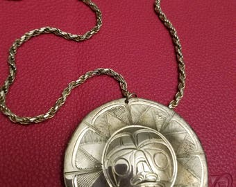 Namgis First Nation silver sun pendant on Sterling chain