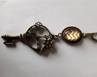 bronze necklace with key and yellow geometric cabochon