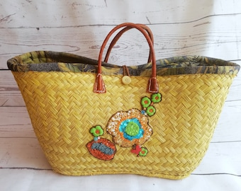 Purse decorated in straw
