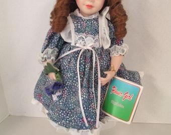 Vintage porcelain ringlet brown hair blue eyed 15 inch doll purple flowered  dress  Flower Girl Exclusive used