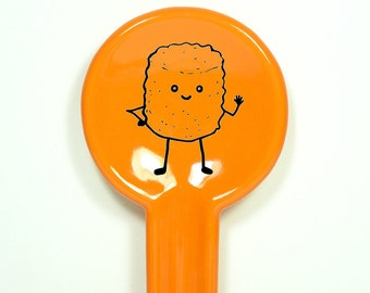 spoon rest featuring Mr.T.Tot, waving hello.  Made to Order/Pick Your Colour