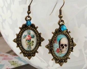 Dangling Cross and skull, ephemera style earrings.