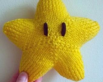 Handmade knitted super mario star