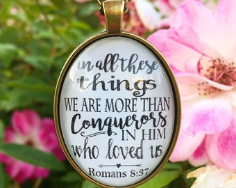 """Oval Bible Verse Pendant Necklace """"in all these things we are more than conquerors in Him who loved us."""" Romans 8:37"""