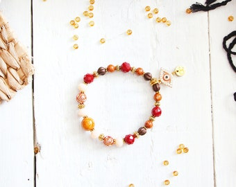 Bracelet Isis, orange, red, cream, brown and golden beads, evil eye charm, ancient egypt inspiration, for women