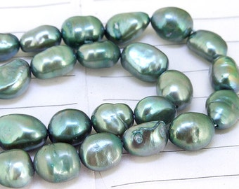 One Full Strand--- Luster Flat Rice  Pure Dark Green Freshwater Pearl----8mm-10mm----about  35 Pieces----15.5 inch strand