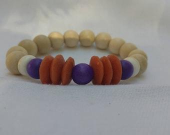 Orange Glass and Purple Wood Bracelet