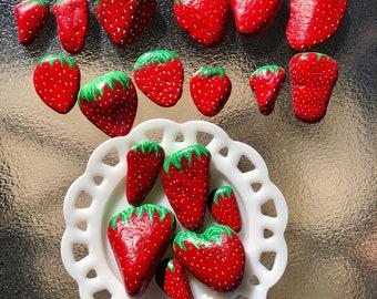 Hand painted strawberry rocks.
