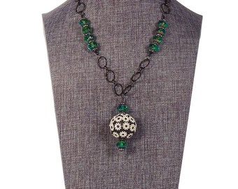 Kashmiri bead pendant with green Czech glass accents on a black chain with a toggle clasp