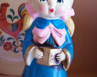 plaster ceramic caroling figurine