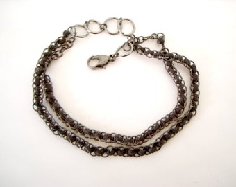 Black Jump Rings Bracelet two strands of small gunmetal jump rings intertwined with black cotton cord