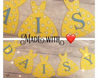 Personalised Wooden dress bunting, children's bedroom, wall hanging