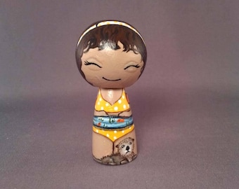 Girl with sea otter Wooden Handpainted Kokeshi Doll