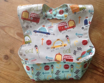 Boy Pocket Bib, On Our Way vehicles by Riley Blake in laminate fabric wipeable, washable BPA Free, with size adjustable snaps