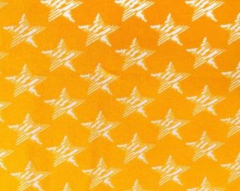 Golden Scribble Stars Cotton lycra knit fabric