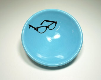 small dish with cat's eyes glasses shown here on Cloudless Blue glaze, made to order / pick your colour