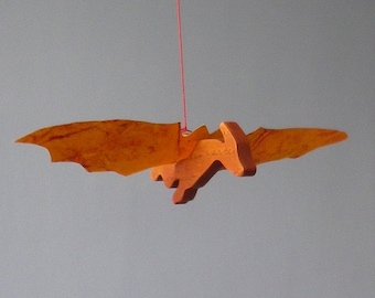 Mobile dragon in wood and paper