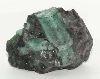 Raw emerald stone of 98 grams with matrix of black mica and quartz.