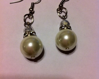 Nice14 mm  pearl earring with cubic zirconia stonesand  silver hook