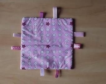 Pink baby tag blanket.