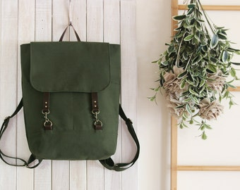 Unisex, Forest green backpack, diaper bag, diaper backpack, laptop bag. 2 front pockets. 7 inside pockets. Waterproof lining available