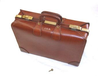 Gorgeous vintage suitcase-belting leather luggage with key