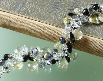 black spinel- golden rutilated quartz - black tourmalated quartz - pyrite - crystal quartz - sterling silver - bracelet