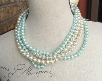 discounted 10 dollars one only.   Blue and ivory muli strand pearl necklace discounted