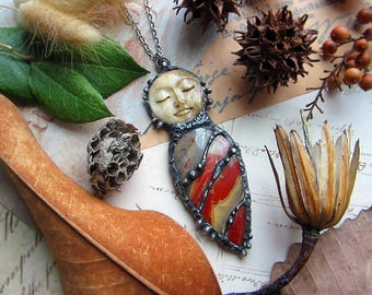 """Necklace """"Universe"""" with multi-color jasper and carved bone sleeping moon face. Custom length stainless steel chain."""