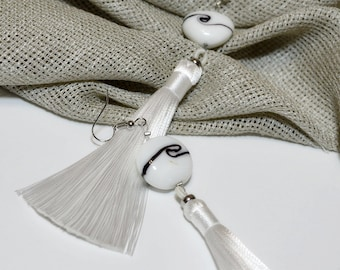 Long white silk tassels and large glass beads