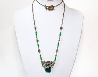 Necklace bronze chain and emerald green pendant