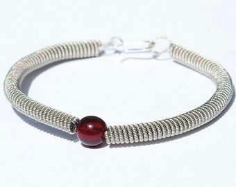 Guitar String Bracelet- Upcycled Guitar String Jewelry with Garnet Red Bead, Music Jewelry, Guitar Player Gift by Tanith Rohe