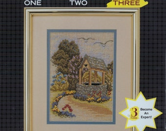 JCA, Inc. #06242, WISHING WELL by Michael A LeClair, counted cross stitch kit, unopened kit, needlework, gift, home decor, level 3 kit