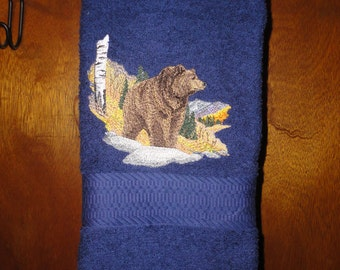 Autumn Grizzly - Embroidered Hand Towel - Shown on Blue
