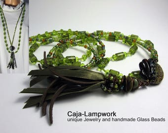 Set of two long chains, green-brown, lampwork, large Raku-Topas lens, pearl-bound leather-silk-tassel
