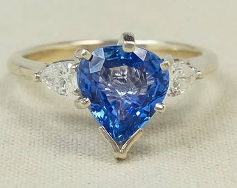 Royalty Inspired 18K White Gold 2.10ct Created Blue Pear Shaped Sapphire & Natural Diamond Accented Gemstone Ring Size 7.5