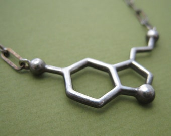 serotonin molecule necklace, styled for men