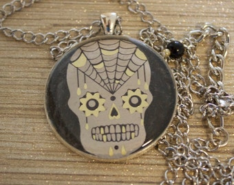 Gold foil white spider web sugar skull pendant necklace on a black background sealed in clear resin // gifts for her // creepy cute // goth