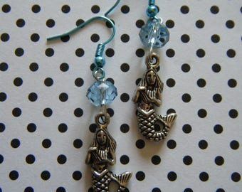 Siren of the sea  silver dangle mermaid earrings with light blue glass beads