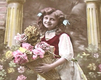 1900s French postcard, Girl with basket of flowers,  RPPC real photo.