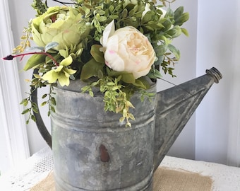 Galvanized watering cans with peonies