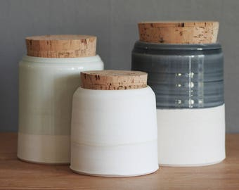 ready made canister. one porcelain pottery jar with natural cork