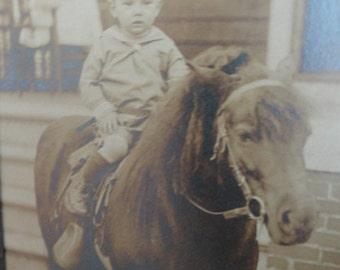 B816)  Antique Silver Photo of Boy on Pony