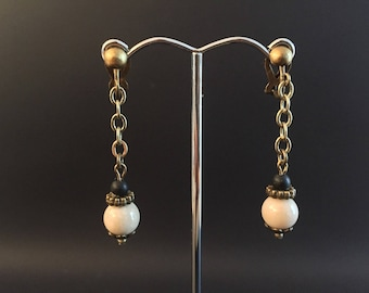 Clip Earrings: beige fossil and matte black stone, chain and bronze rondelle beads
