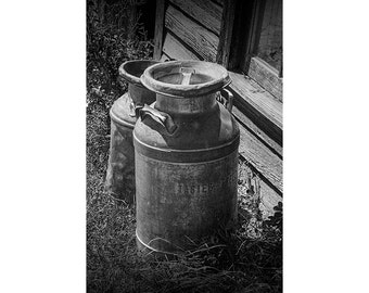 Black & White Photo of Vintage Creamery Milk Cans by the old Prairie Homestead by the Badlands South Dakota No.BW7561 Still Life Photograph