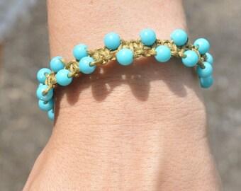 ladder bracelet with blue beads