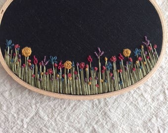 Oval Floral Field Embroidery Art on Black Linen