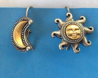 Vintage Fun JJ gold tone sun & moon in pewter tone pierced earrings.
