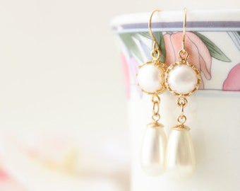 Long Pearl Earrings • Gold and pearl drop earrings set with a white pearl • Bridal jewelry