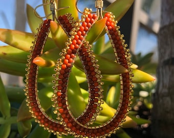 Orange and gold beaded teardrop shapped hoops with gold plated ear wires